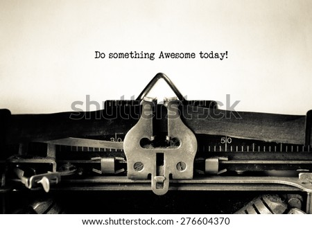 Do something awesome today message typed on a vintage typewriter