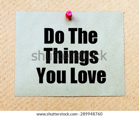 Do The Things You Love written on paper note pinned with red thumbtack on wooden board. Motivation conceptual Image - stock photo