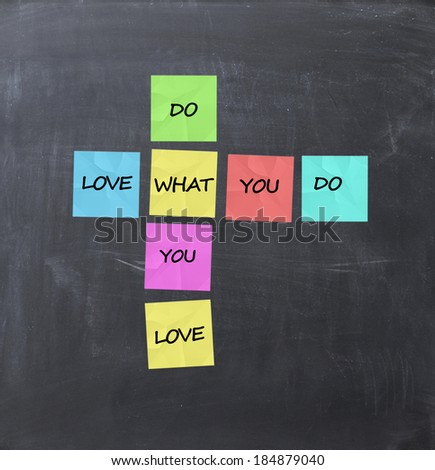 Do what you love concept on a blackboard - stock photo