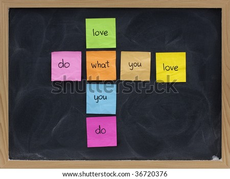 do what you love, love what you do - happy life and work concept presented on blackboard with colorful sticky notes, white chalk smudges - stock photo