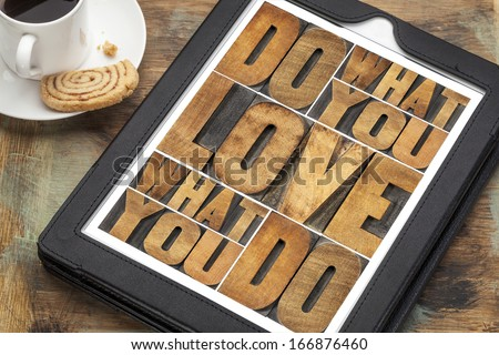 do what you love, love what you do - motivational word abstract in vintage letterpress wood type on a digital tablet - stock photo