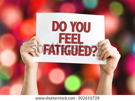 Do You Feel Fatigued? card with bokeh background - stock photo