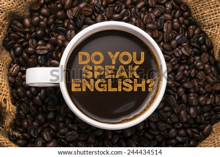 do you speak english? coffee mug with coffee beans background - stock photo
