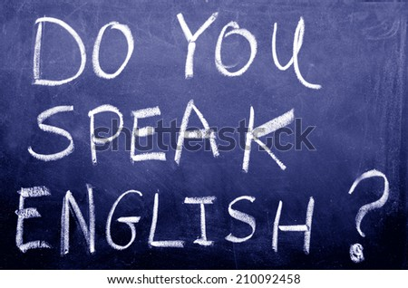 Do you speak english? Handwritten with white chalk on a blackboard.concept photo of learning and teaching English for travel, work and communication. (BW) - stock photo