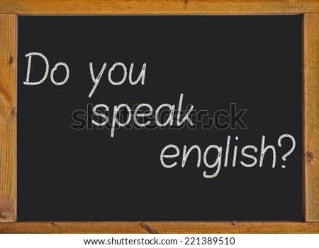 do you speak english? on a blackboard - stock photo
