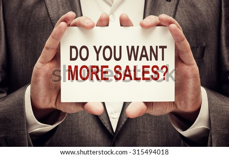 Do you want more sales? card in male hands - stock photo