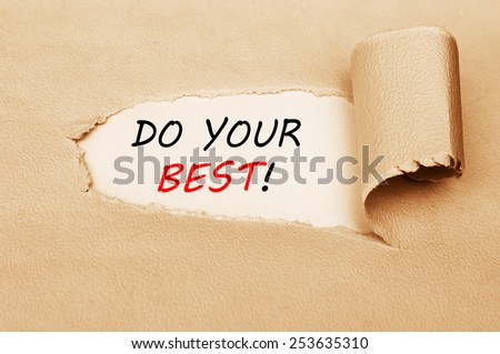 Do Your Best! written behind a torn paper - stock photo