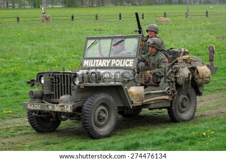 DOBRANY, CZECH REPUBLIC - MAY 1, 2015: Jeep Willys from Military Police unit. Liberation festival to 70th Anniversary of the Liberation by the US Army and the End of the Second World War in Europe. - stock photo