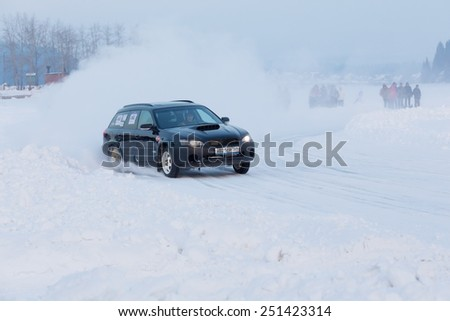 Dobryanka, Russia - February 7, 2015. Urban ice race. Black Lada VAZ-2114 goes on sports track ice racing - stock photo
