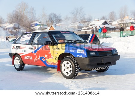 Dobryanka, Russia - February 7, 2015. Urban ice race. Bright VAZ-2114 stands on snow race track - stock photo