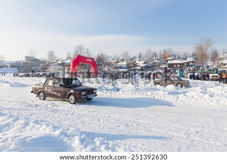 Dobryanka, Russia - February 7, 2015. Urban ice race. Purple VAZ-2107 against background of red gate in winter - stock photo