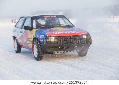 Dobryanka, Russia - February 7, 2015. Urban ice race. VAZ-2114 with bright stickers stands on winter road front view - stock photo