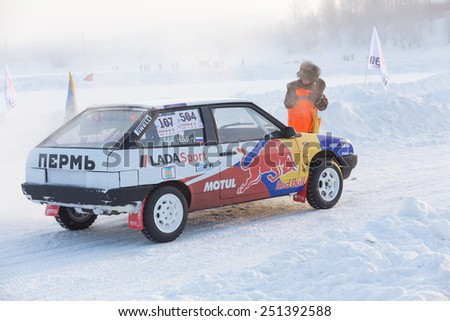 Dobryanka, Russia - February 7, 2015. Urban ice race. VAZ-2114 with bright stickers stands on winter road - stock photo