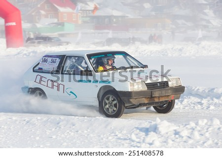 Dobryanka, Russia - February 7, 2015. Urban ice race. White VAZ-2114 racing on a snowy highway - stock photo