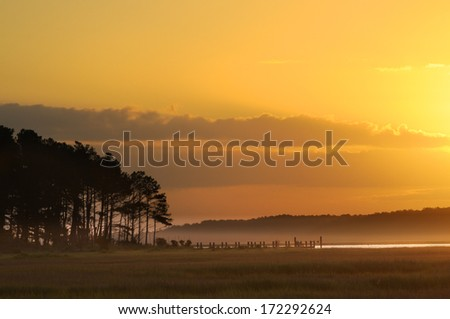 Dock and Golden Sunrise  - stock photo