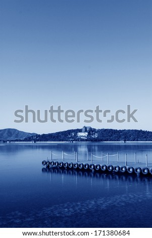 dock and the tower of Buddhist incense in Kunming Lake, in the Summer Palace on December 10, 2011, Beijing, china.  - stock photo