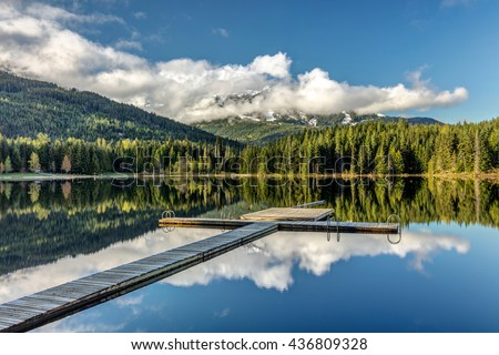 Dock at Lost lake in Whistler, British Columbia - stock photo