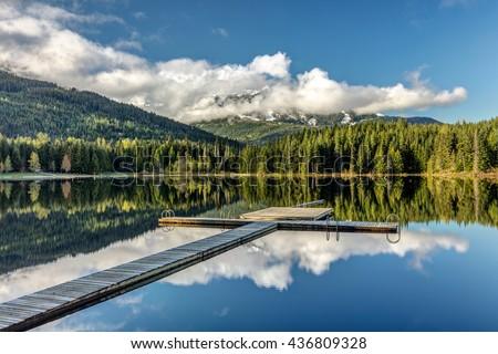 Dock at Lost lake in Whistler, British Columbia - stock photo