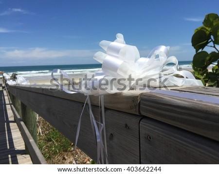 Dock leading to beach wedding - stock photo