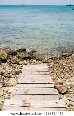 dock rock and blue sea in Thailand - stock photo