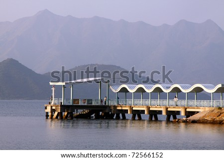 Dock to pier under blue sky in Hong Kong - stock photo