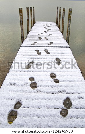Dock With Footprints In Snow - stock photo