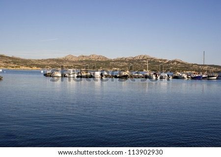 Dock with small boats in Italy . - stock photo