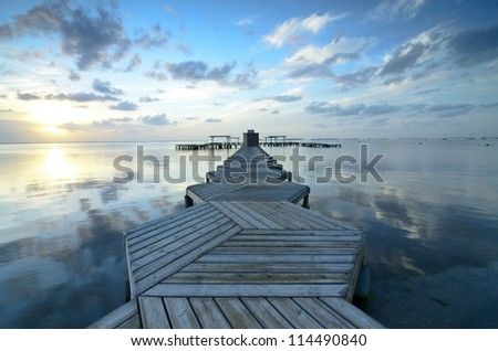 Dock with wood in zig zag in the morning at Mar Menor, Spain - stock photo