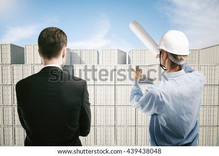 Dock worker pointing at cargo containers and explaining something to businessman. 3D Rendering - stock photo
