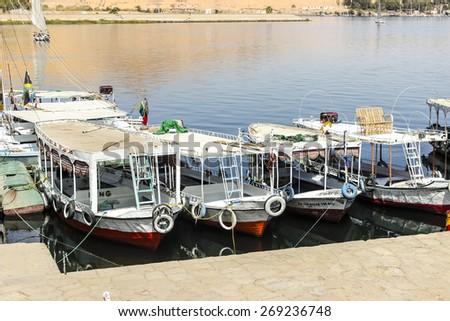 Docked feluccas in Nile river in Aswan Egypt - stock photo