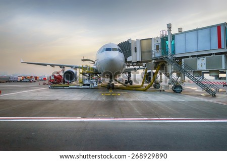Docked jet aircraft in Dubai international airport - stock photo