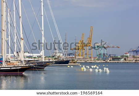 Docked Sailing Ships with the Seaport in the Background in Valencia, Spain - stock photo