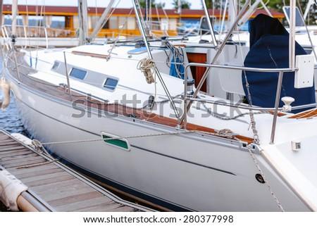 Docked yacht / Yacht docked along dock or pier. - stock photo