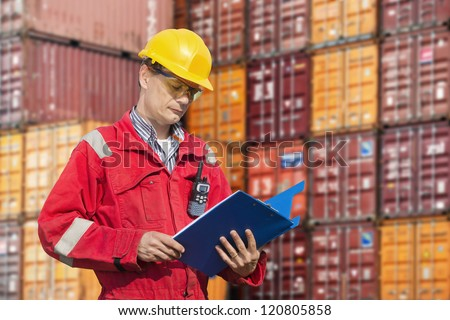 Docker checking consignment notes - stock photo