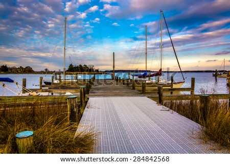 Docks in the harbor at St. Michael's, Maryland. - stock photo