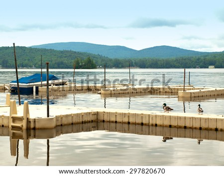 docks on a scenic lake in the adirondack mountains in new york state - stock photo