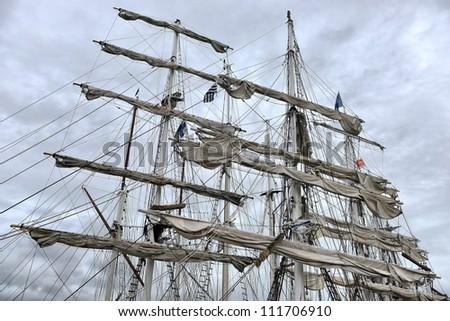 Dockside of old sailing ship - stock photo