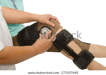 doctor adjustable angle knee brace support for leg or knee injury - stock photo