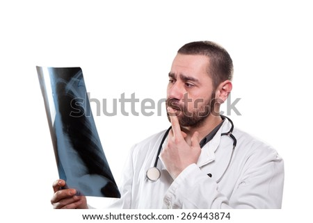 Doctor analysing his patient's x-ray - stock photo
