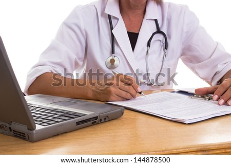 Doctor analyzes patient medical history form - stock photo