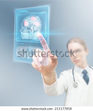 Doctor analyzing brain activity - stock photo