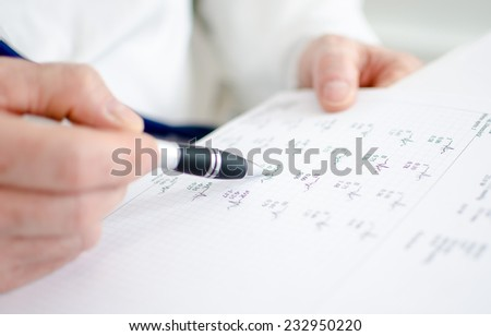 Doctor analyzing electrocardiogram, closeup - stock photo