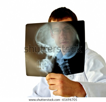 Doctor analyzing X-Ray - stock photo