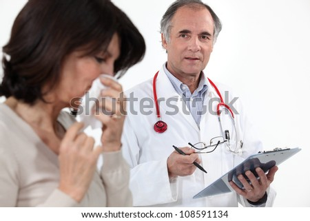 doctor and female patient with flu - stock photo