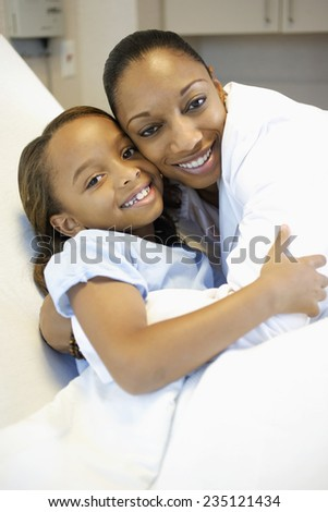 Doctor and Girl Hugging - stock photo
