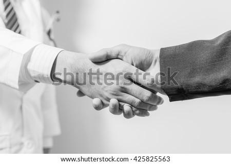 doctor and her lawyer shaking hands. handshake on white. handshake Business and doctor concept.
