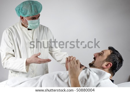 Doctor and his patient talking - stock photo