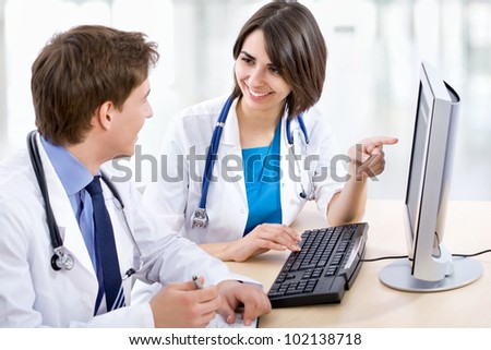 Doctor and his young colleague - stock photo