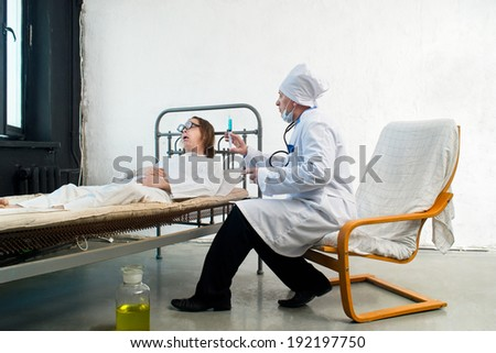 Doctor and infirm patient in a hospital