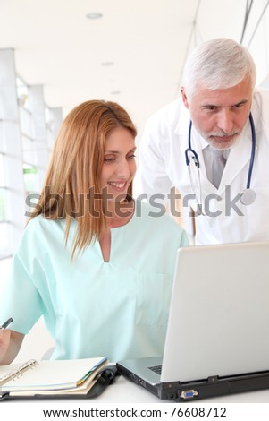 Doctor and intern working in hospital
